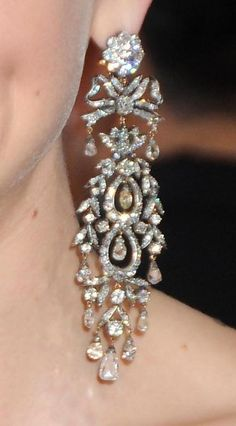 "Fred Leighton Diamond Earrings - Best Actress Nominee (2010) Carey Mulligan's dark Prada gown with cutaway hem was perfectly accented with 19th century cascading diamond and diamond briolette earrings and a delicate Everlon Diamond Knot Ring, all by Fred Leighton. ""These earrings came into our collection a week before the Oscars,"" says Rebecca Selva of Fred Leighton, ""and from the moment we saw them we knew they were for Carey."""