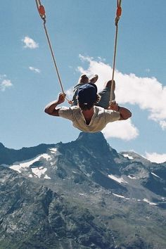 The swing at the end of the world located literally on the edge of the cliff at La Casa Del Arbol in Baños, Ecuador.