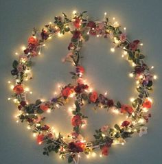 Peace sign made from flowers & light art