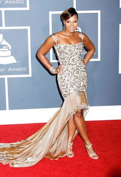 "Acclaimed as the ""Princess of Hip Hop and R&B"" Ashanti is wearing a Tony Ward dress at the Grammys"