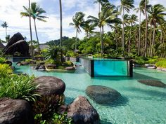 Laucala Island Resort in Fiji has an epic pool within a pool, with an above-ground glass lap pool embedded inside the larger, more natural-looking pool.