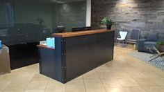 Industrial metal & wood reception desk created by Artfully Rogue for the company Vizzo which is located in Scottsdale AZ.