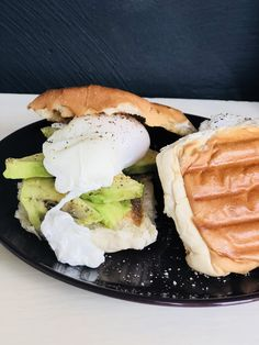 A nice green avocado.. with an egg that have swam in a beautiful pool of cooking water and vinegar, with some nice crunchy toast..