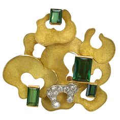 Andrew Grima Diamond and Tourmaline Brooch 1970 | From a unique collection of vintage brooches at https://www.1stdibs.com/jewelry/brooches/brooches/