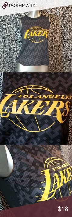 💚50% OFF💚LOS ANGELES LAKERS Tank 💚50% OFF BUNDLES of 2+ MOVING SALE💚 Boys size 8 but would look adorable on a woman. Would fit a XS to S.   Why SHOP MY Closet? 💋Most NWT or Worn Once 💋Smoke/ Pet Free 💋OVER 450 🌟🌟🌟🌟🌟RATINGS & RISING! 💋TOP 10% Seller  💋TOP RATED 💋 FAST SHIPPER  💋BUNDLE DISCOUNT OF 20% 💋VIP REWARDS w/ EACH PURCHASE  💋QUESTIONS?? PLEASE ASK! ❤HAPPY POSHING!!! 💕 LA Lakers Tops Tank Tops