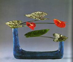 ikebana, Japanese Flower Arrangement - The red Anthuriums look beautiful with the blue vase.