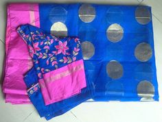 Royal Blue Kota Saree with Pink Border paired with same colour maggam work blouse having elbow length sleeves.