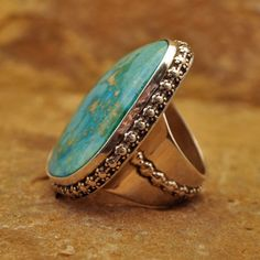 Handmade Sterling Silver ring with Turquoise stone and decorative Flower wire around stone as well as the ring shank. This ring was made by Jimmie Benally Sr. of New Mexico. Navajo (?)