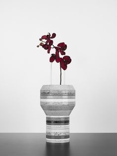 FORM US WITH LOVE, SLAB VASE: silestone rings vary in size and are cut so the shape of the vase changes with each assembly.
