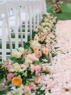 pretty arrangements lining the aisle that can be reused at the reception