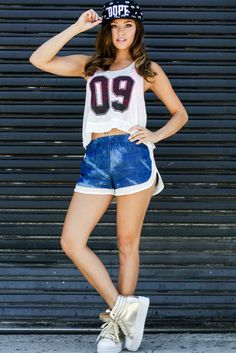 This cool sport number tank features a high low cut and sheer fabric. Wear it over your favorite bandeau or a bikini top and match it with a pair of denim shorts for super cute summer look. $28 at Obsezz.com Tags: Street Style, Street Fashion, Hiphop Fashion, Hiphop Style