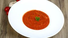 Summer Discovery by Pierre   Traditional tomato gazpacho, Extra virgin herb oil, cherry tomato salad and tapenade crouton