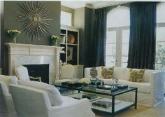 Black curtains with grey wall
