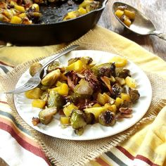 A mix of tender maple roasted Brussels sprouts and butternut squash are topped with crunchy pecans and coconut bacon to make this flavorful vegan side dish!