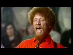 The Dubliners- Black Velvet Band    Luke Kelly might have been able to eat his pint glass after he finished his Guinness with those chompers.