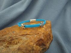 5mm Turquoise Flat Leather Bracelet with Silver Star Sliders and Textured Magnetic Clasp