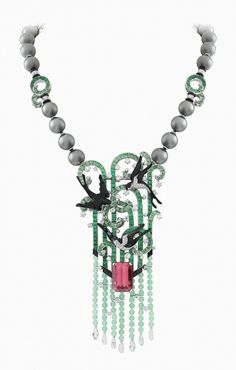 Van Cleef & Arpels. Palais de la chance High Jewellery collection. Lucky-charm nature Hirondelles necklace and detachable clip, white gold, diamonds, emeralds, tsavorite garnets, onyx, black lacquer, grey cultured pearls, chrysoprase beads and one 19.59-carat emerald-cut pink tourmaline.