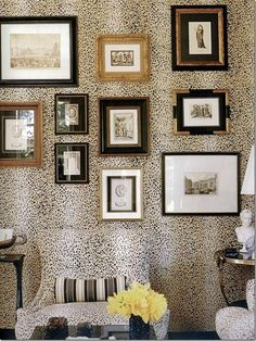 Go sophisticatedly bold by hanging black and gold frames on animal-printed wallpaper. This will give your wall gallery a ravishing texture.