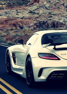 Yes, I will take you for a drive, a long drive to anywhere and everywhere. Mercedes Benz SLS AMG.