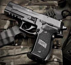 Sig Sauer P226 MK25.  Heavy but well balanced.  Solid in the hand.  April 2014.