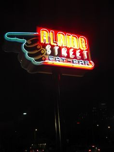 Alamo Street Eat Bar has a great collection of food trucks. Try WhereYaAt's amazing spicy fries... tip have beer in hand ready to put out the 5 alarm. ASEB sign logo by of course Robert Tatum