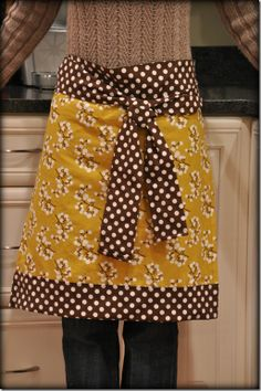 DIY Apron...very easy!  It took me a couple hours (brushing up on my rusty sewing skills...) but I probably could make one in 1 hour!  VERY CUTE!! -LO