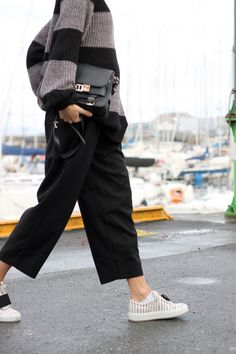 Blogger Tine Andrea | Sweater (Weekday). Pants (Nelly). Sneakers (Acne Studios). Bag (Proenza Schouler).