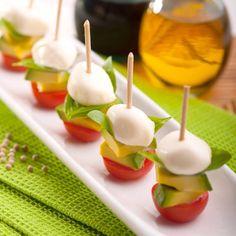 Easy appitizer: tomato, avocado & pearl mozzarella.