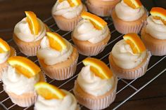 Easy Easy Creamsicle cupcakes! Holy cow I'm obsessed with this girl's blog. So many yummy ideas here! :)