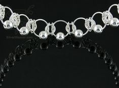 Silverweaver - Item NK013 *will have to check, but if this is the same lady and she's doing similar work to what she was doing several years ago, she makes and designs some FANTASTIC chainmaille jewelry! ~L
