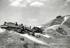 circa 1940, Great Britain, Bren gun carriers negotiate hilly terrain on the South Downs