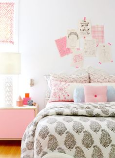 Fantastic kid's room features sketches and pink fabric samples taped on wall above a white baroque ...