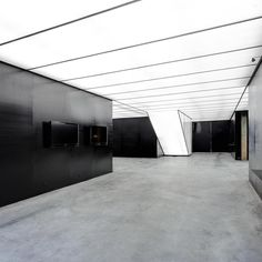 O-Office Architects converted an abandoned industrial site near Guangzhou into a sleek gallery showcasing stone art and culture. Translucent polycarbonate panels float overhead and contain LEDs, providing a contrast to the structure's original concrete flooring.: LIKYFOTO. #architecture #interior #design #interiordesign #gallery #china #art... - Interior Design Ideas, Interior Decor and Designs, Home Design Inspiration, Room Design Ideas, Interior Decorating, Furniture And Accessories