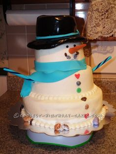 Coolest Snowman Birthday Cake... This website is the Pinterest of birthday cake ideas