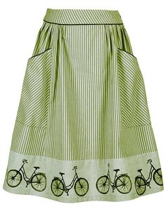 Bike - Green http://www.ecouture.com/bike-green.html?___store=gb&___from_store=gb Bike is a fine, feminine and comfortable skirt, which can be worn on many different occasions. The skirt is sewn in a gorgeous, organic cotton [GOTS certified]. And the handprinted bikes matches the piping. The skirt is flexible because of the good width, the elastic in the back and a zipper on the side.