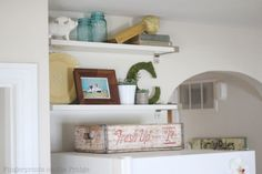 I want to put shelves above my refrigerator like this. So cute!