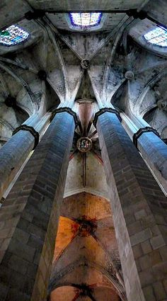 Santa Maria del Mar, Barcelona, Catalonia - interior view to ceiling, massive stone columns with stained glass windows at the top