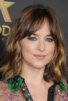 """The Look: Consider this the evolution of last season's Short Shag–you've grown some length and have more to play with, so try some loose waves and add piecey, brow-skimming bangs like Dakota Johnson's for an instant update.  Pro Styling Tip: """"If my client gets a haircut every eight to ten weeks, I have them come in at the fifth week to get a bang trim,"""" Maldonado says of maintaining a favorable length. As for achieving that tousled look, he suggests plumping hair with Oribe Curl by…"""