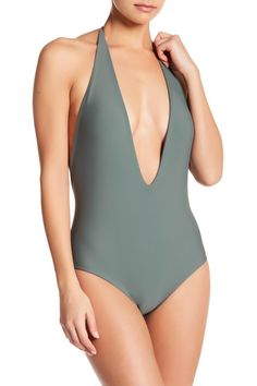 A plunging neckline spotlights this daring one-piece swimsuit styled in fun summer colors.