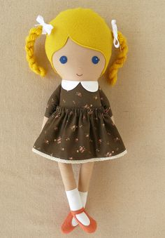 This is a handmade cloth doll measuring 18 inches. She is wearing an old fashioned brown floral dress with a matching removable skirt, white socks, and coral mary janes. Her blond hair is worn in high twisted braids and accented with white grosgrain ribb Doll Crafts, Diy Doll, Sewing Crafts, Sewing Projects, Doll Toys, Baby Dolls, Homemade Dolls, Fabric Toys, Sewing Dolls