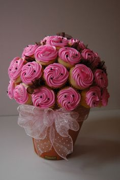 Flower pot, styrofoam ball, toothpicks, mini cupcakes, ribbon for the bow. Green tissue between would be cute or more ribbon. Cupcake Wedding Centerpieces, Flower Pot Centerpiece, Wedding Cupcakes, Mini Cupcakes, Pull Apart Cupcakes, Cupcake Cakes, Cupcake Flower Pots, Edible Bouquets, Cupcake Bouquets