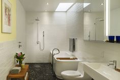 Open shower next to bath tub - BWA - layout for kids bathroom