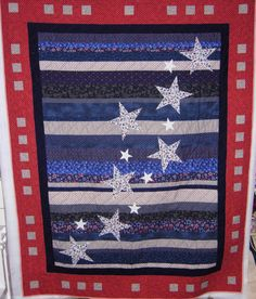 Quilt of Valor - I enjoyed doing one of these in the different size stripes, I used a plain  border and in every block a thin purple stripe around varying widths in red, white & blue, very nice.