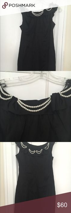 Black dress with pearls at collar- petite Black dress with straight hem. Double strand of pearls at collar. Sleeveless. Donna Ricco Dresses Midi