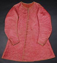 """What a beautiful coat: """"The absence of a seam at the waist is very unusual for this date. Men's coats, known as doublets, were generally made with one."""" 1645-50, Quilted red-pink satin, interlined with wool and quilted in a diamond pattern. Glasgow Museums"""