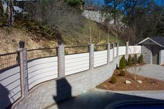 Curved iron pool fencing with lap siding filler