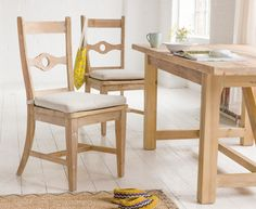 The extremely comfy Chinwag kitchen chair's classic design is set off against its reclaimed timber. Comes with cushion pads and sold in pairs. Work it!