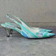 """Vintage Emilio Pucci Kitten Heels HP @miaowza Beautiful geometric pattern, slingback, unique silver heel design 2 1/2"""".  Emilio Pucci Designer. Made in Florence (Firenze) Italy. late 80s / early 90s. There's a tiny bit of glue discoloration on the strap. See photo 4. At the tip of one toe there is the slightest bit of fade when compared to the other tip. I only noticed upon very close inspection. Emilio Pucci Shoes Heels"""
