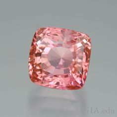 """Sri Lanka is one of the few sources for padparadscha sapphires. Poetic descriptions for this light to medium pinkish orange to orange-pink sapphire include """"salmon,"""" """"sunset"""" and """"ripe guava."""" In what piece of jewelry would you wear this beautiful gem? Photo: Robert Weldon/GIA, Dr. Edward J. Gübelin Collection"""