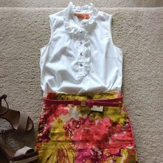 """Tory Burch Deneuve top Tory Burch Deneuve top. White with high collar ruffling and ruffling and buttons half way down the front. Sleeveless. 69 cotton 26 nylon 5 spandex. Silver buttons. Laying flat approx 25"""" long, approx 17.5"""" pit to pit. Size 8. Excellent condition. #286 Tory Burch Tops Blouses"""
